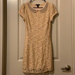Cream lace mini dress with sleeves, pearls